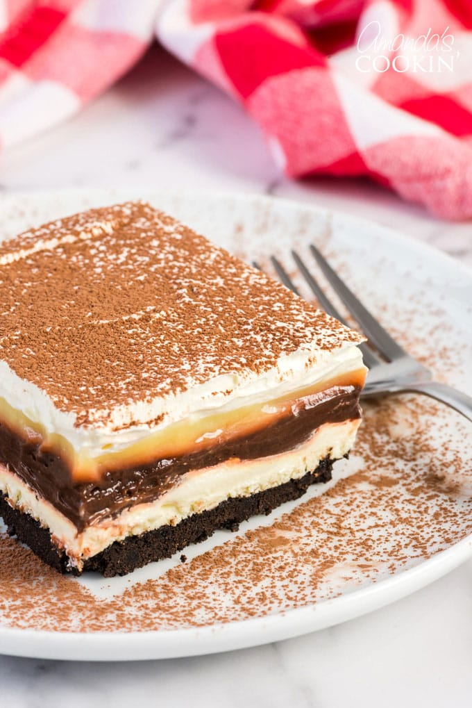 chocolate and vanilla pudding layered dessert on a plate