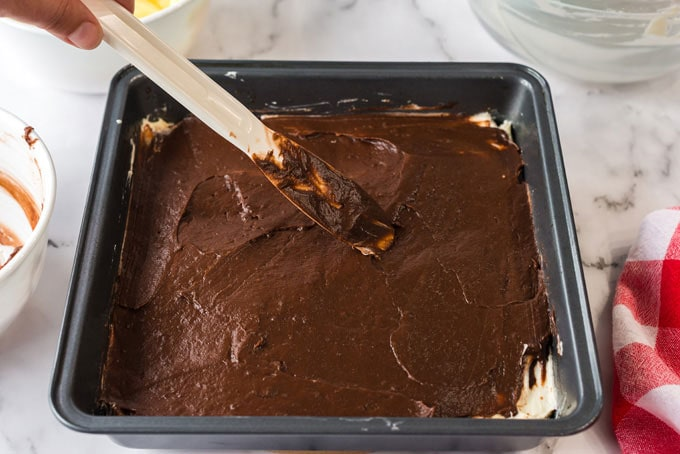 spreading chocolate pudding layer