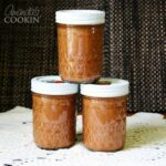 Three jars of crock pot apple butter.