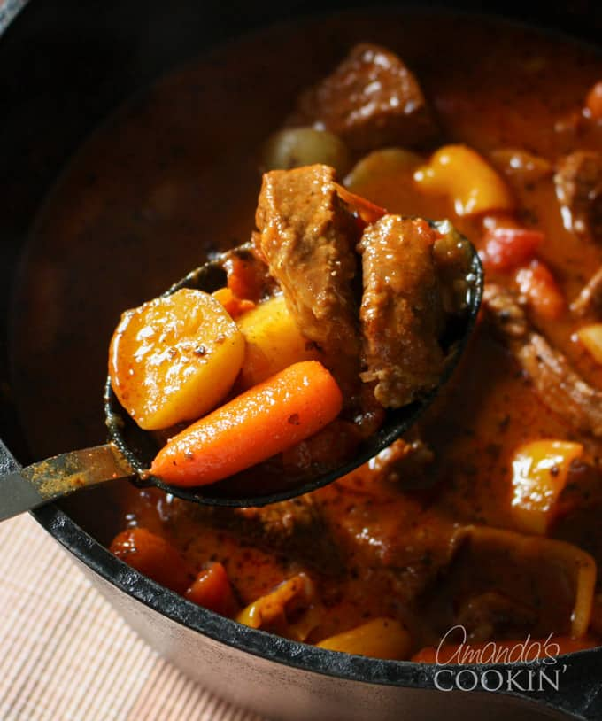 dutch oven goulash on a spoon