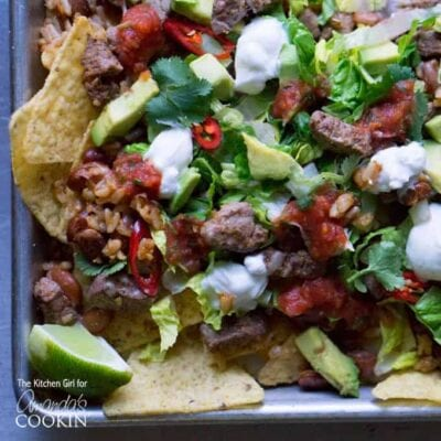 Filet Mignon Steak Nachos - Made with tender filet mignon, avocado, taco seasonings, tomatoes and other nacho ingredients!