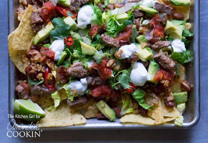 A close up overhead photo of filet mignon steak nachos.