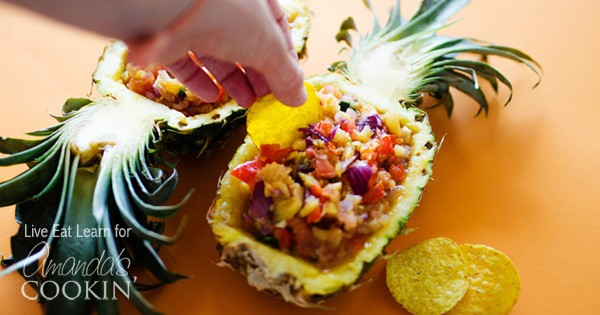 This easy pineapple salsa is packed full of sweet pineapple, tomatoes, peppers and other delicious salsa ingredients. Perfect for cookouts and barbecues!