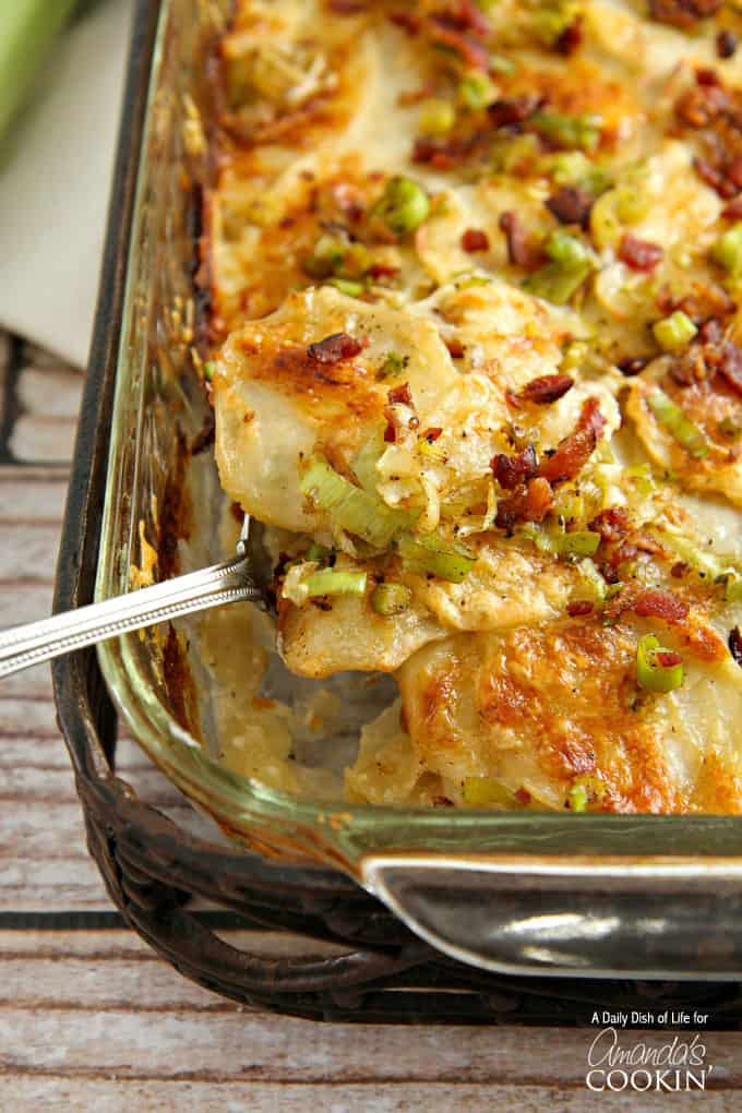 Potatoes Au Gratin are a long time comfort food favorite. Au Gratin Potatoes with bacon, cheese and leeks make for a delicious casserole side dish.
