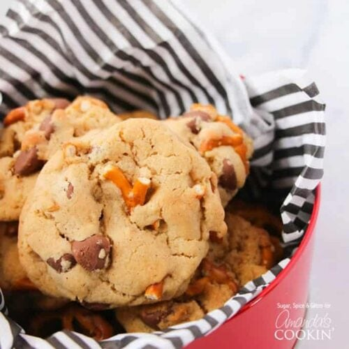 A close up photo of pretzel chocolate chip cookies in a tin.