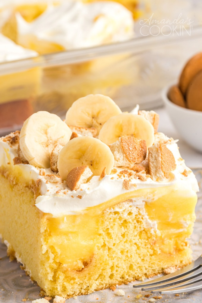 close up photo banana pudding poke cake slice