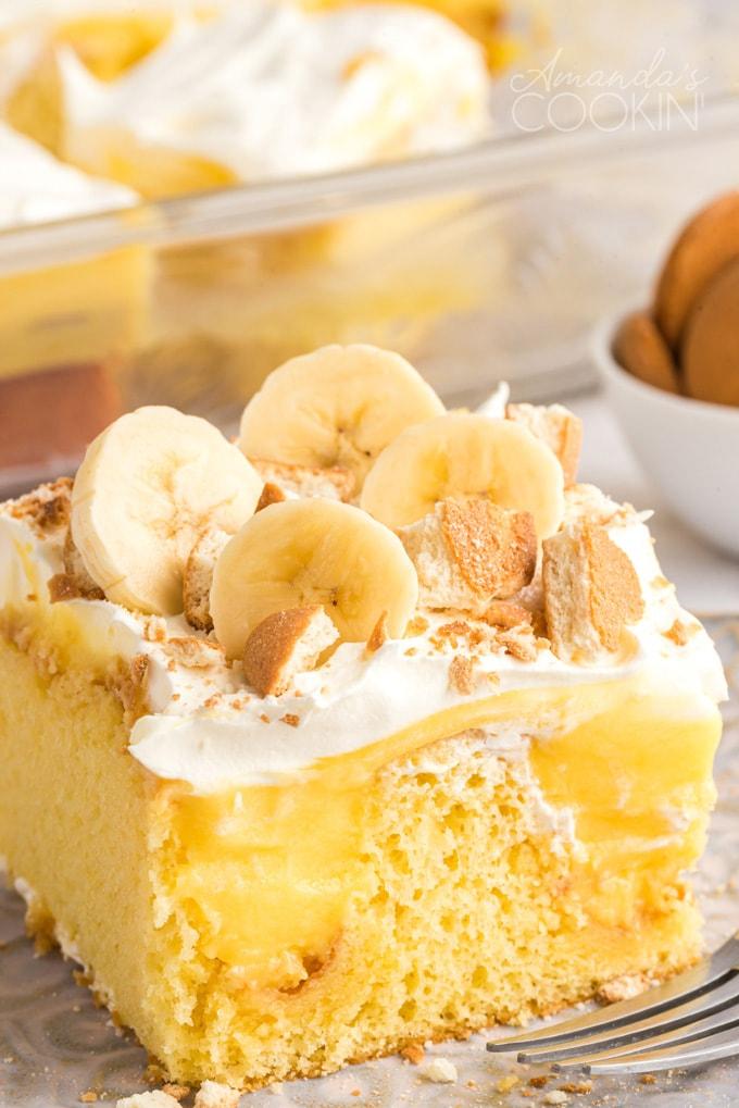 close up photo banana pudding poke cake slice