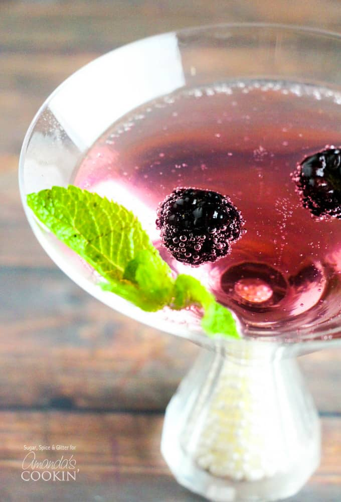 This delicious blackberry gin martini is garnished with fresh blackberries and mint leaves. A marvelous blackberry martini for your in season berries!