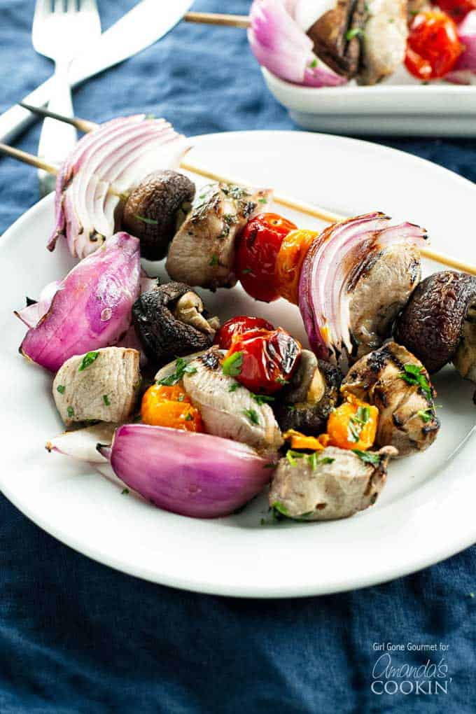 Summer wouldn't be complete without tender, juicy marinated grilled chicken and flavorful mixed vegetables threaded onto skewers, perfect chicken kabobs.