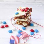 This patriotic candy bark combines the flavors of regular almond bark and saltine toffee. This red, white and blue candy bark is great for the 4th of July!