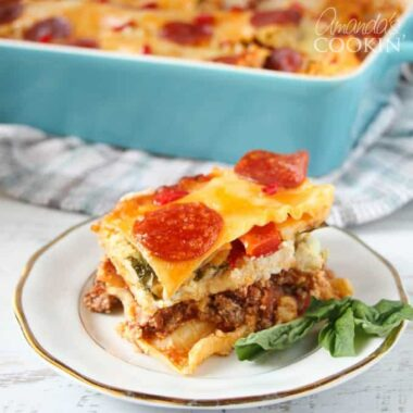Love pizza and lasagna? This time make pizza lasagna and satisfy both loves! This recipe has tender lasagna noodles and your favorite pizza flavors.