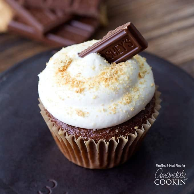 If you're having a camping or summer party this year, try these S'mores Cupcakes! These cupcakes pack all the flavor of s'mores in an easy to eat cupcake.