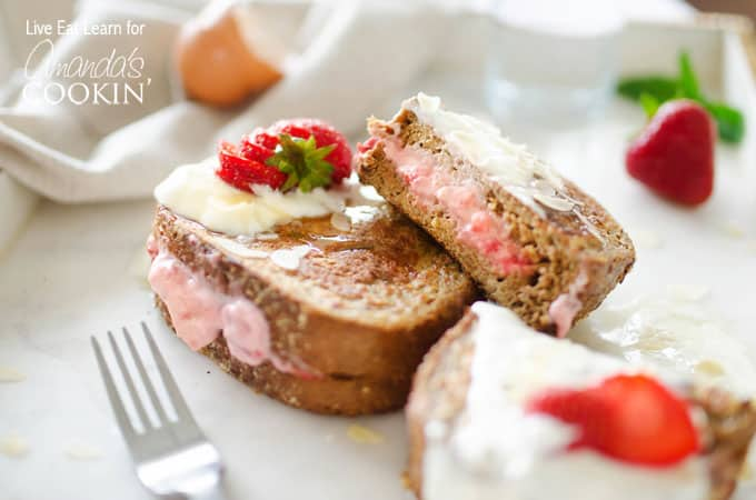 This French toast is stuffed with sweet strawberries and cream filling. Turn your usual breakfast into something amazing - Strawberry Stuffed French Toast!