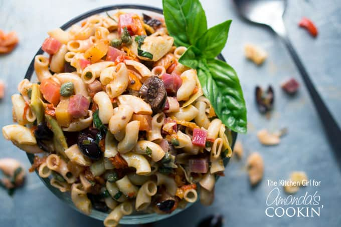 Mediterranean Pasta Salad uses early summer produce and pantry staples to create a fresh, festive, summer salad experience. Perfect pasta salad for parties!