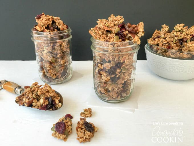 Autumn harvest fruit and nut granola in mason jars.