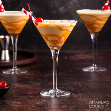 butterscotch milkshake cocktail in a martini glass with a cherry garnish