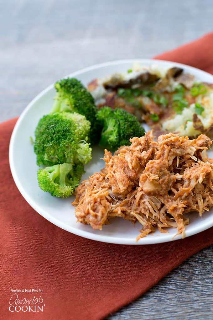 Easy Crockpot Chicken BBQ - Such an easy and delicious meal for any time of the year! Tasty shredded chicken perfect for sandwiches or just eat with a fork.