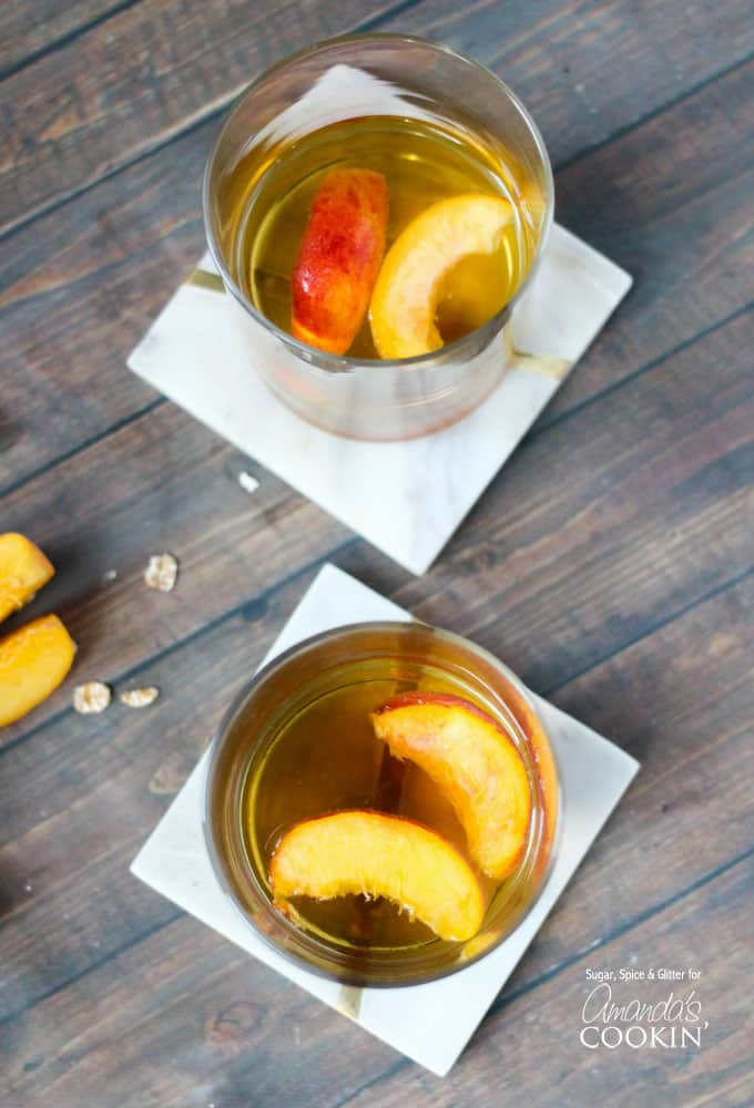 This recipe for peach pie cocktail brings summer to you year-round. With a touch of cinnamon this adult beverage is reminiscent of the perfect peach pie.