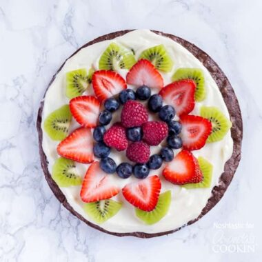 Make a delicious brownie fruit pizza for your next party or get together. Fresh fruit, cream cheese frosting and a chewy brownie base speak for themselves!