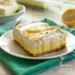 Lemon cheesecake pudding dessert is a no-bake dream! Graham crackers, lemon pudding, cream cheese and whipped topping combine in this layered lemon dessert!