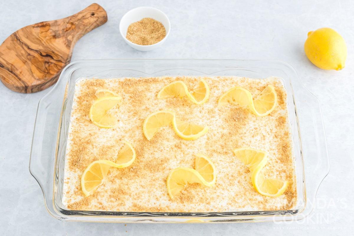 pan of dessert garnished with lemon
