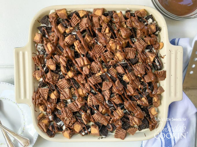Peanut Butter Oreo No Bake Cheesecake combines cheesecake w/ Oreo cookies & Reese's Peanut Butter Cups to create a decadent dessert!