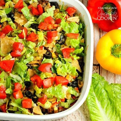 An overhead of taco casserole in a large baking dish.