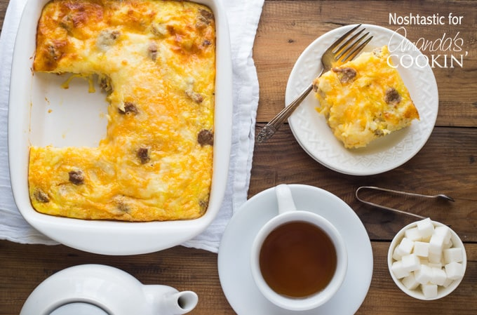 An overhead photo of a pan of turkey hash brown breakfast casserole with a serving resting on a plate to the side.