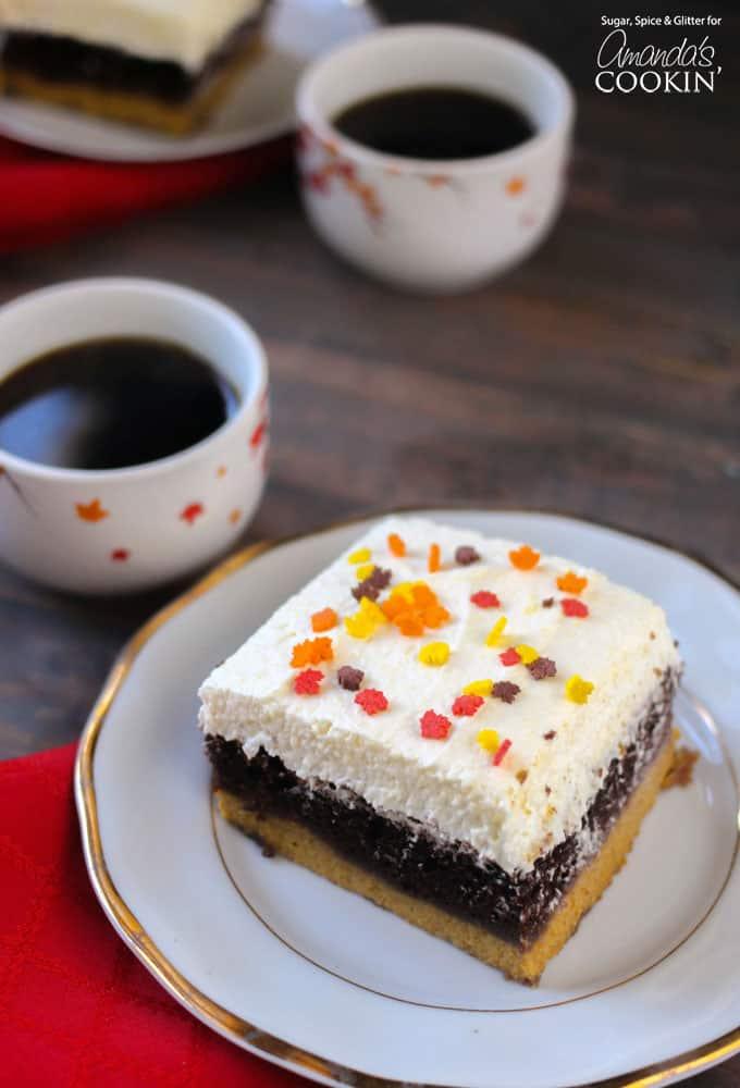 A square of pumpkin magic cake on a plate.