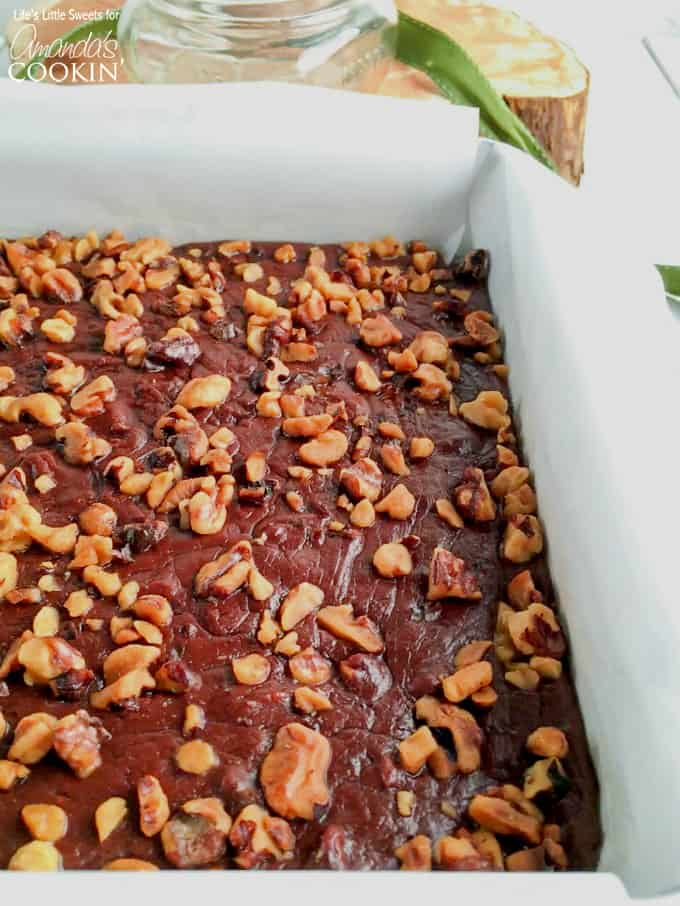 A a close up of a pan filled with chocolate walnut fudge.