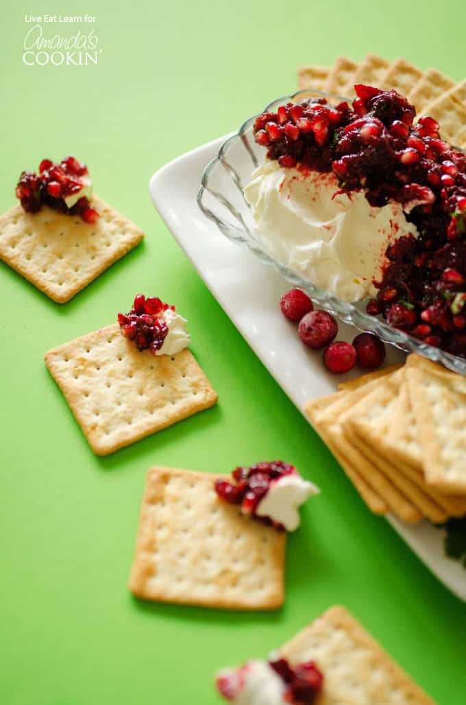 Savory cranberry salsa puts a unique twist on cranberries. Spoon over a block of cream cheese and eat with crackers for a festive holiday appetizer.