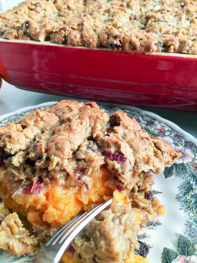 A close up of oatmeal cookie sweet potato casserole on a plate.