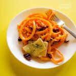 A close up of a plate of butternut squash pasta.
