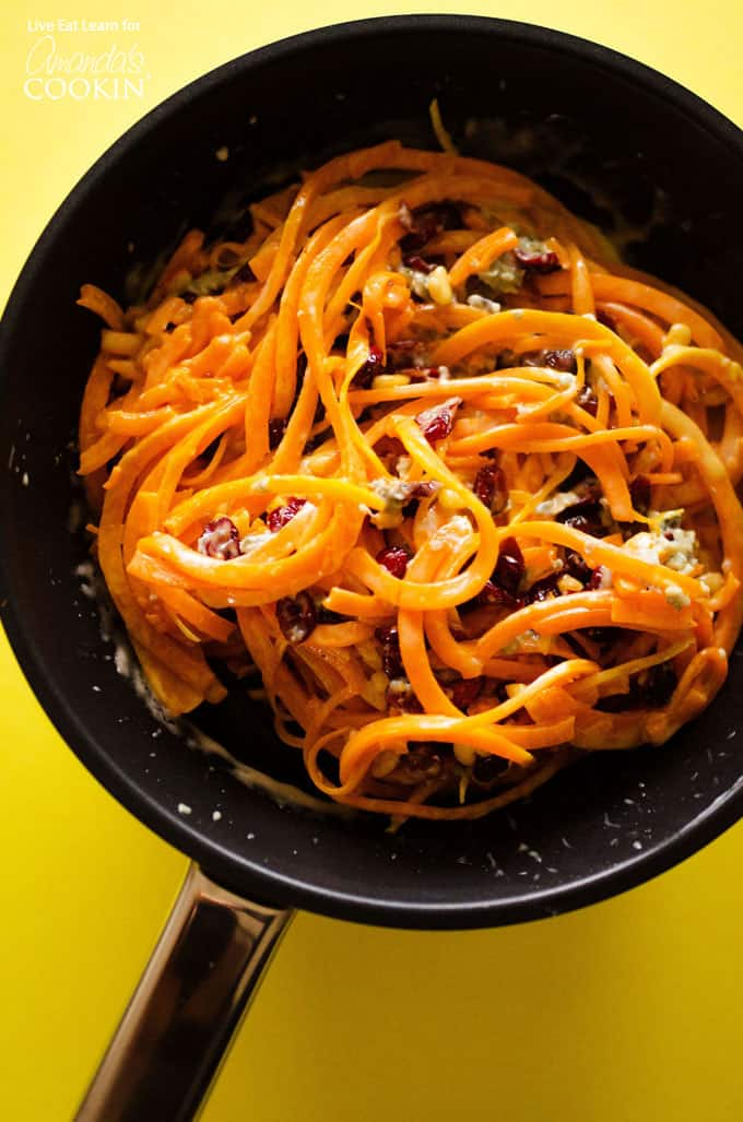 A large saute pan filled with butternut squash pasta.