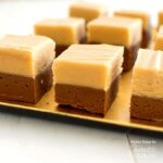 A close up of chocolate peanut butter fudge squares.