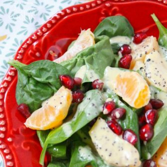 Pomegranate Clementine Spinach Salad - packed with vitamin-rich spinach, vibrant pomegranate seeds & plump clementines drizzled with poppy seed dressing.