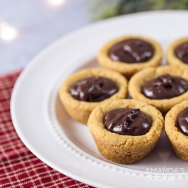plate of cookie cups filled with chocolate