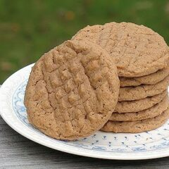 A close up photo of a stack of Nutella peanut butter cookies resting on a plate.