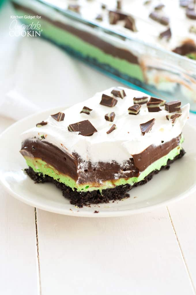 Mint Chocolate Lasagna is a no-bake, one-pan dessert with layers of mint cream cheese, chocolate pudding and Cool Whip on an Oreo crust