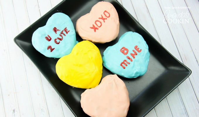 The nice part is that you can play off the original conversation heart idea yet you have the freedom to choose the quotes and colors which can make these brownies an even more special treat!