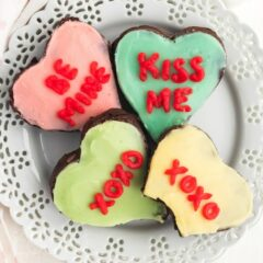 heart shaped decorated brownies on a plate