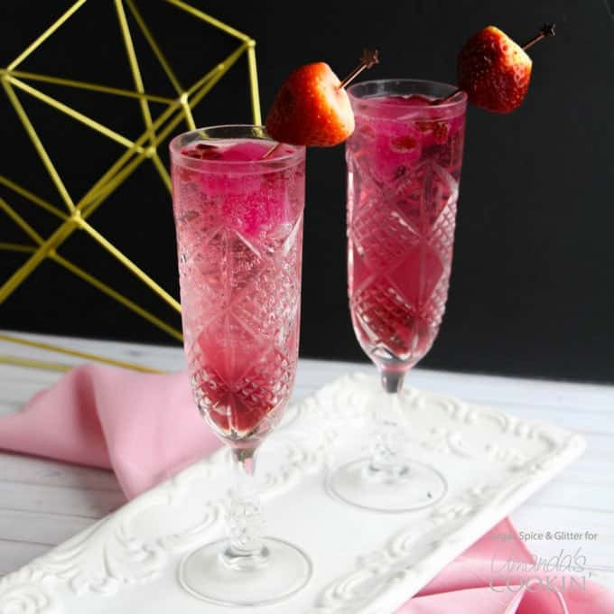 Valentine's Day Cupid's Cocktail with strawberry garnish in champagne flutes