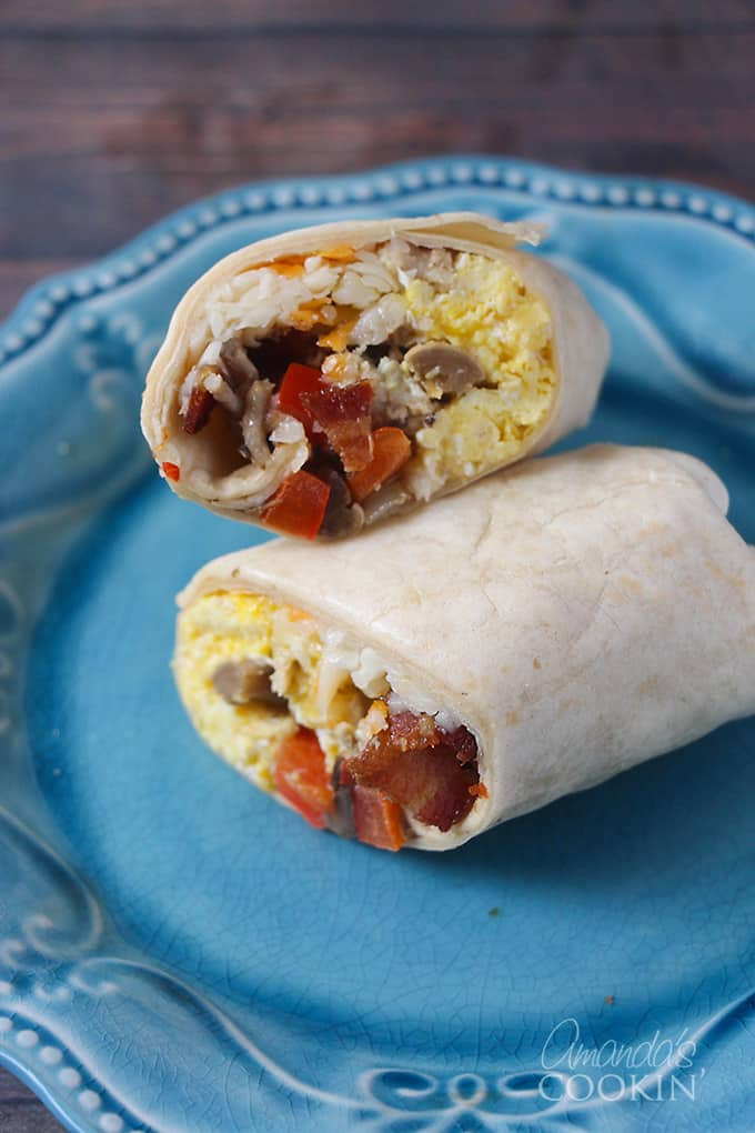 Wouldn't it be great to have a hot breakfast from the microwave in just two minutes that you can eat with one hand? Make these freezer breakfast burritos ahead of time and enjoy them for days to come!