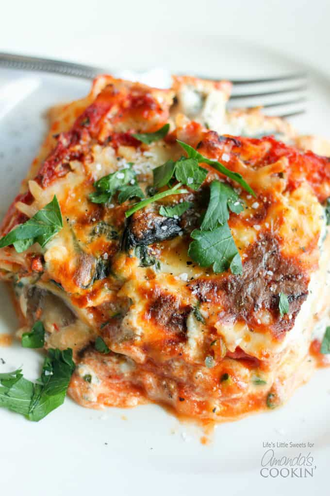 slice of veggie lasagna garnished with parsley