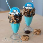 two cookie monster shakes with straws