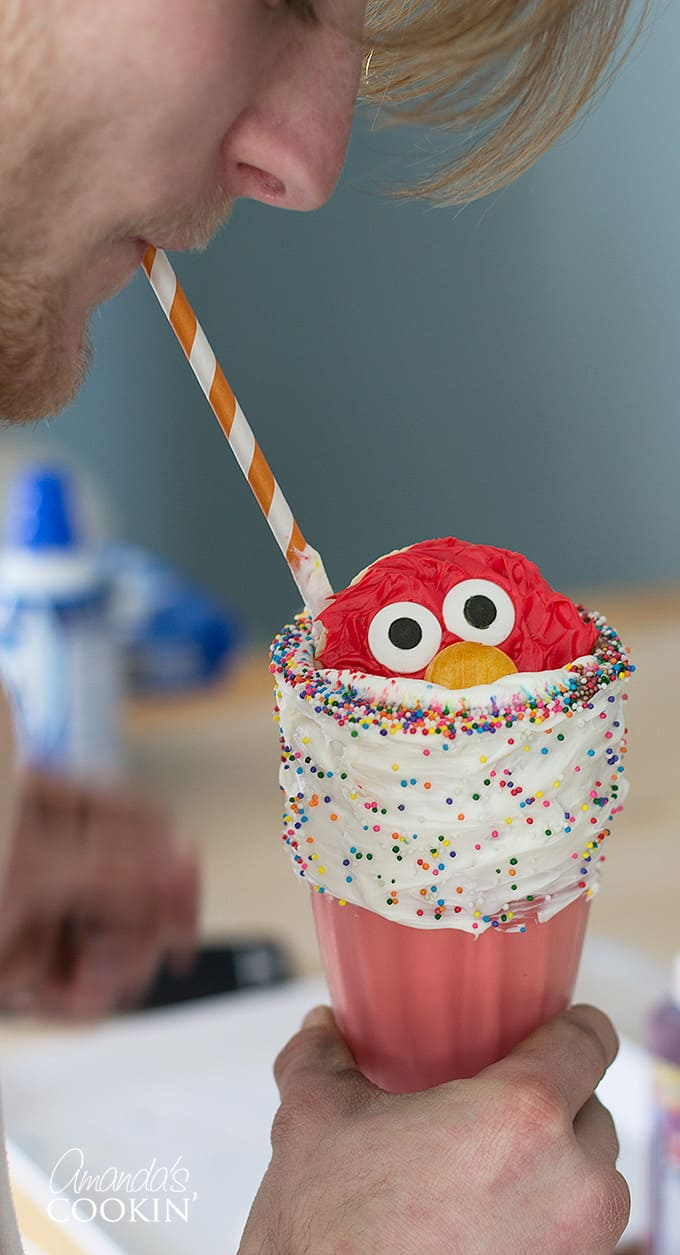 Boy drinking elmo freakshake out of straw