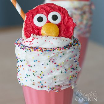 These Elmo Freakshakes are super simple and full of character! A simple milkshake recipe turned into a fun and out-of-the-box freakshake!