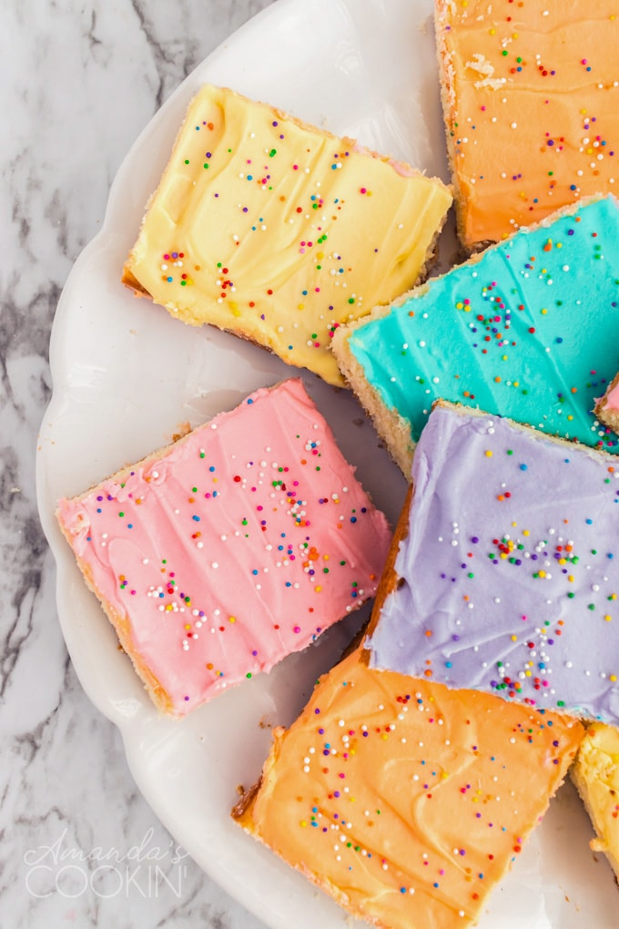 plate of sugar cookie bars with colorful frosting