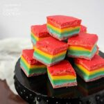 This rainbow fudge is sure to put a smile on everyone's faces! This recipe is a fun and ultra colorful twist to ordinary chocolate fudge.