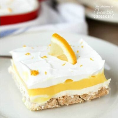 This Lemon Lush dessert recipe is the perfect one-pan treat for your Spring and Summer picnics and gatherings. So light and refreshing with lemony goodness!
